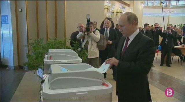 R%C3%BAssia+celebra+les+eleccions+presidencials+sense+cap+dubte+sobre+la+reelecci%C3%B3+de+l%27actual+president+Vladimir+Putin